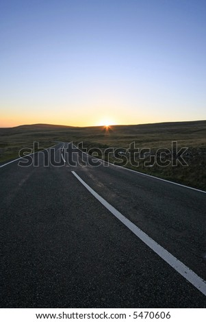 The Black mountains road - Wales UK Sunset with sun peaking over the hills - stock photo
