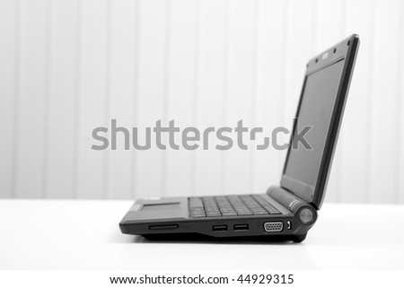 The black open laptop on light table