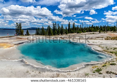 The Black Pool with Yellowstone Lake in the Background in Yellowstone National Park, Wyoming, USA.