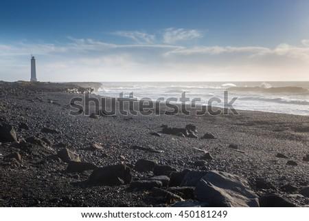 The black volcanic beach near Malariff lighthouse, Snaefellsjokull National Park, Iceland - stock photo