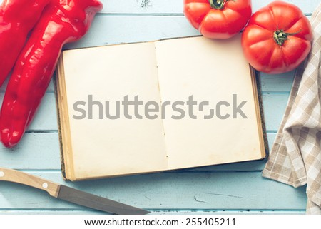the blank cookbook and vegetable - stock photo