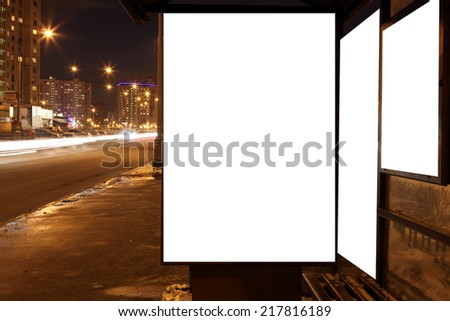 The Blank sign at bus stop at evening in city - stock photo