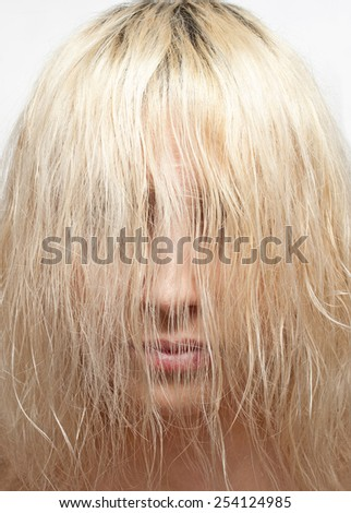 The blonde covered her face with hair - stock photo
