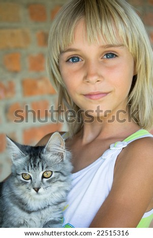 The blonde small girl with a kitten - stock photo