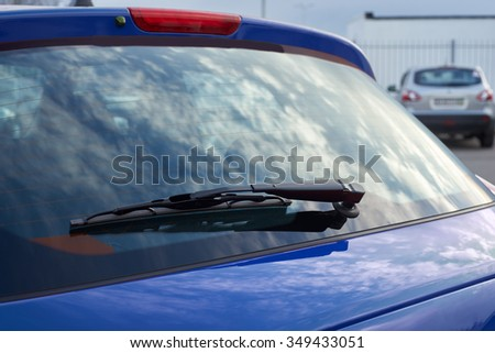 The blue car rear wipers