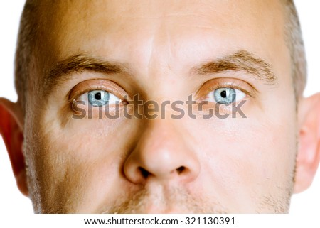 The blue-eyed man. The face close up. Studio. isolated - stock photo