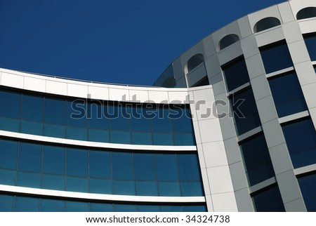 The blue facade of a modern building - stock photo
