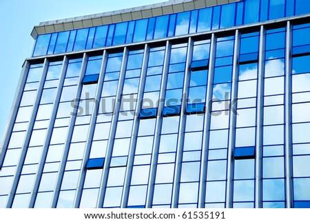 The blue facade of a modern building - stock photo
