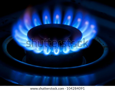 The blue flame of a cooker burner. - stock photo