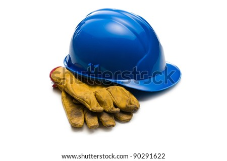 the blue hardhat and leather working gloves - stock photo