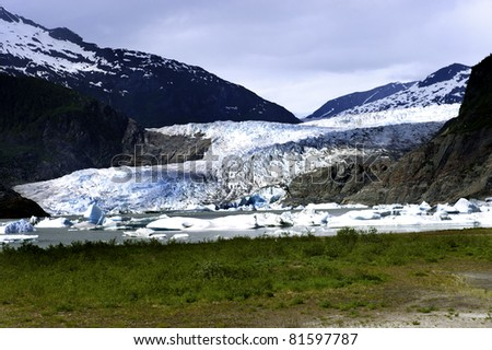 The blue Mendenhall glacier in summer - stock photo
