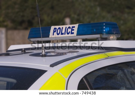 The blue roof lights of a British police car. Outline path included. - stock photo