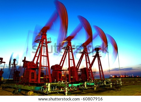 The blue sky of the pumping unit - stock photo