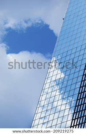 The Blue Sky Reflected In The Skyscraper - stock photo