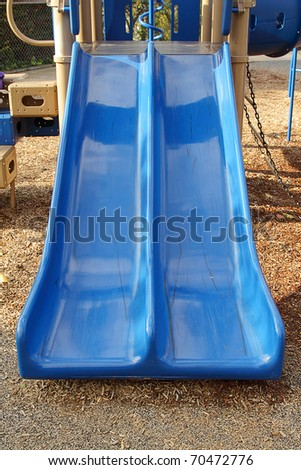 The blue slide on the children's playground - stock photo