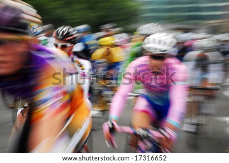The blurred cyclists at cycle event Tour of Britain 2008 - stock photo