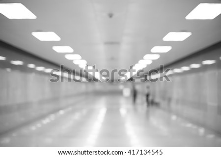The blurring of corridor inside the metro station. (black and white) - stock photo