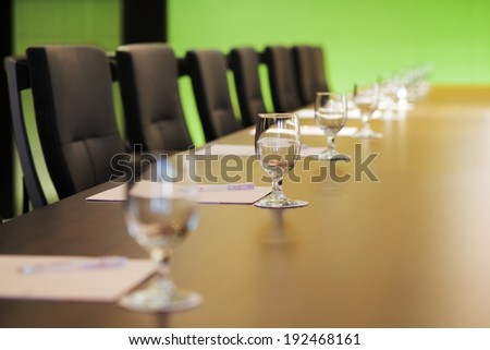 The boardroom table is set for the Annual General Meeting - stock photo