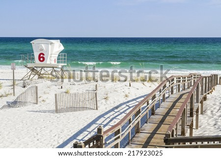 The boardwalk and number 6 lifeguard station at Park West on the western end of Pensacola Beach, Florida. - stock photo