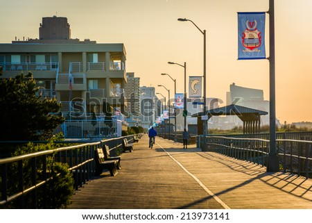 The boardwalk at sunrise in Ventnor City, New Jersey. - stock photo