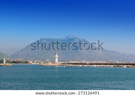 The boat floats near a beacon. Alanya. Turkey - stock photo