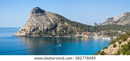 The boat floats on the Gulf. Mountain in the sea. Black Sea. Ukraine. The seaside town. Panorama - stock photo