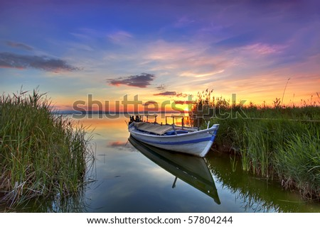 the boat in the landscape of colors - stock photo