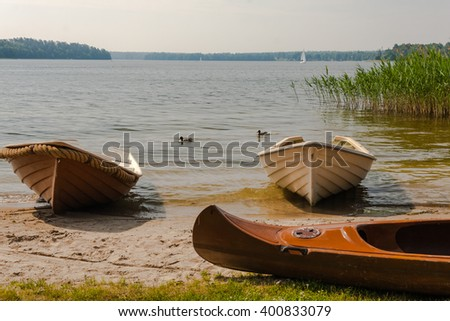 The boat on the lake shore in Poland. - stock photo