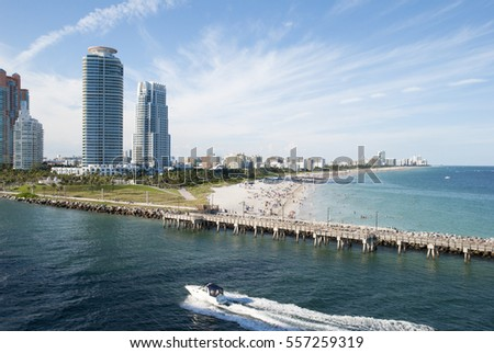 The boat passes by South Pointe Beach in Miami (Florida).