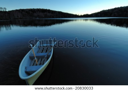 The boat which floats in the shore of the daybreak - stock photo