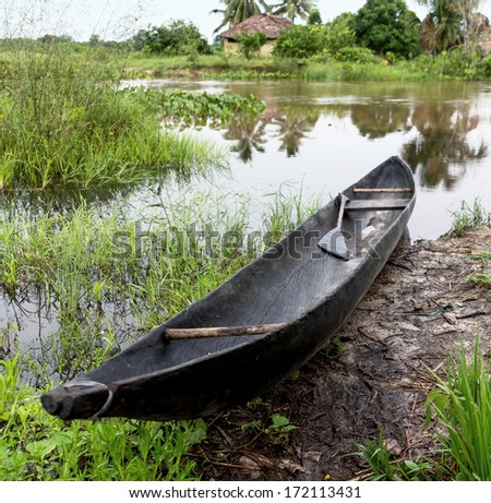 The boat with oars on the shore near the american Indian settlements in the Delta of the Orinoco - Venezuela