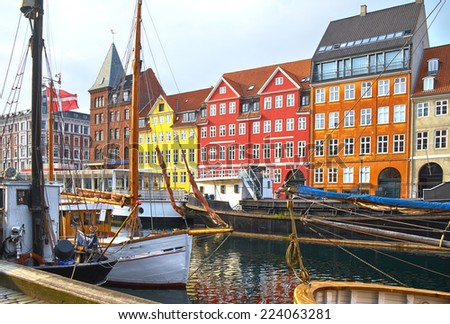 The boats and ships in the calm hurbour of Nyhavn, Copenhagen, Denmark. Nyhavn  (New Harbour) is waterfront, canal and entertainment district in Copenhagen. - stock photo