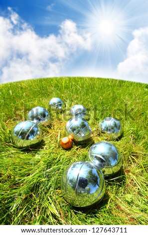 The bocce balls on the green. Close up with shallow dof. - stock photo