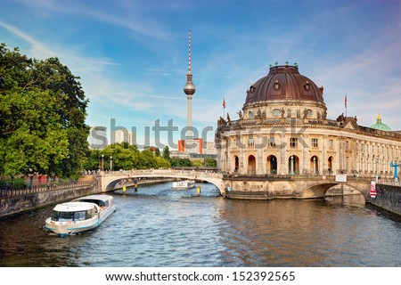 The Bode Museum on the Museum Island in Berlin, Germany. Tourist ship on River Spree - stock photo