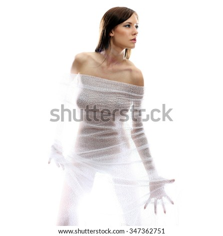 The body of a beautiful naked woman through the transparent fabric on a white background