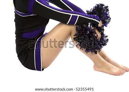 The body of a cheerleader barefoot and with her pom poms - stock photo