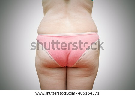 The body of a fat woman on a gray background. - stock photo