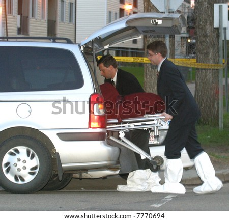 The body of a murder victim is removed from the crime scene in Edmonton,Alberta,Canada. - stock photo