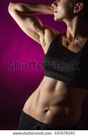 The body sports an attractive woman on red background - stock photo