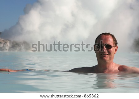 The boiling steam jets heat up an outdoor pool - stock photo