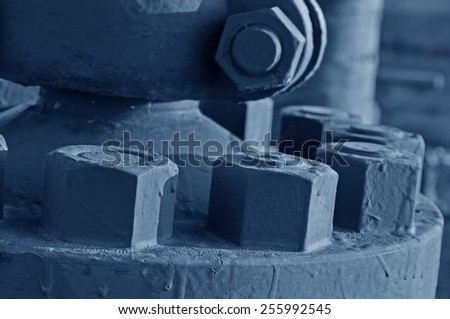 The bolts and nuts on the industrial equipment - stock photo