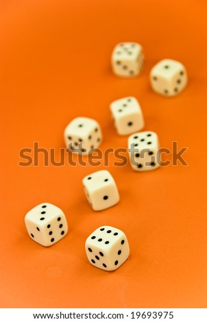the bone to the game on the orange  background - stock photo