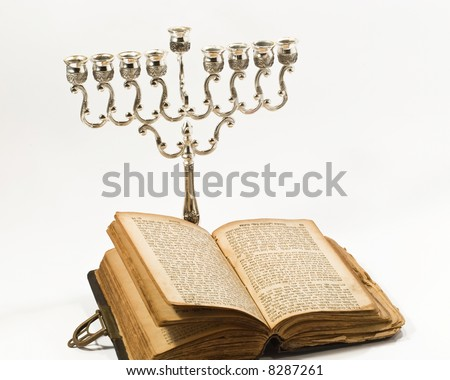 The book and candlestick - stock photo