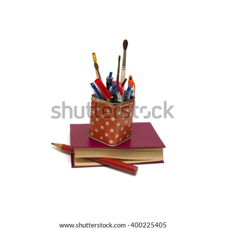 The book, big pencil and metal jar with a stationery on a white background  - stock photo