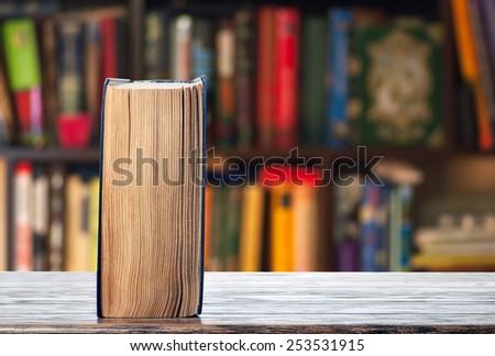 The book is on the shelf - stock photo