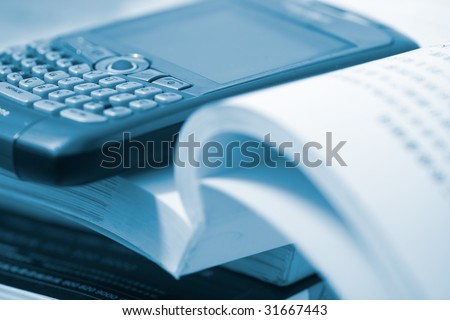 the book with the blackberry cellphone. - stock photo