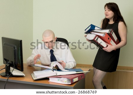The bookkeeper and the secretary on a workplace at office - stock photo