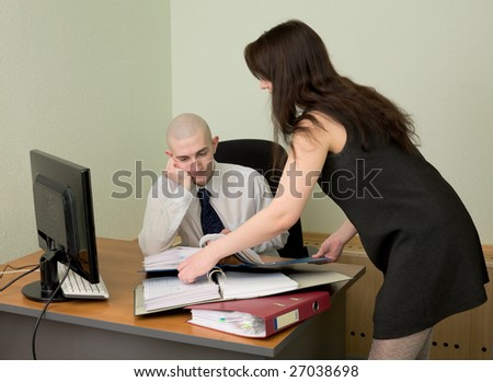 The bookkeeper and the secretary on a workplace at office