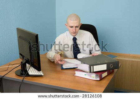 The bookkeeper on a workplace at office - stock photo