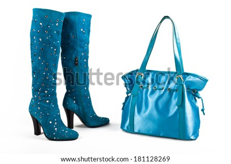 The boots and the bag of turquoise color. - stock photo